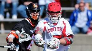 Stony Brook midfield Alex Corpolongo shoots in the