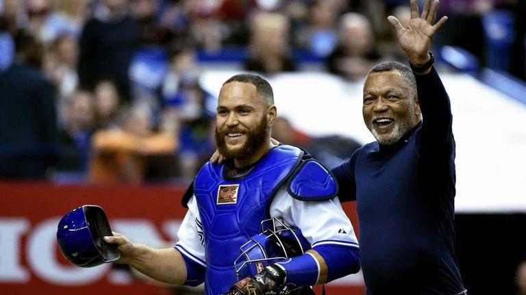 Toronto Blue Jays catcher Russell Martin walks off