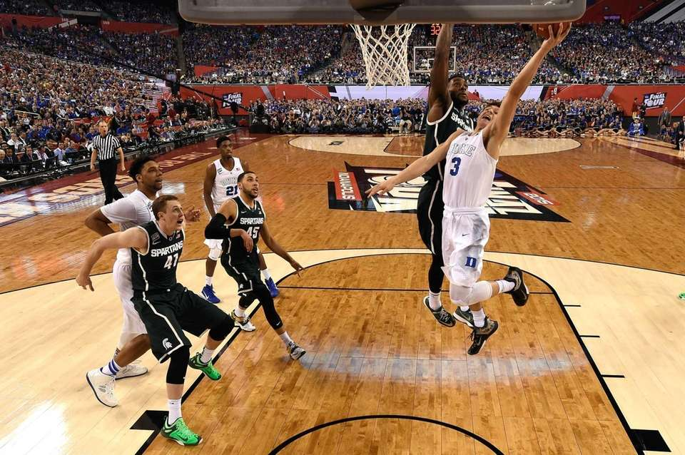 Grayson Allen of the Duke Blue Devils drives