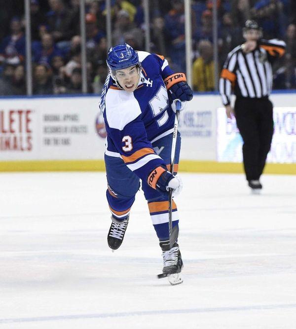 New York Islanders defenseman Travis Hamonic shoots the
