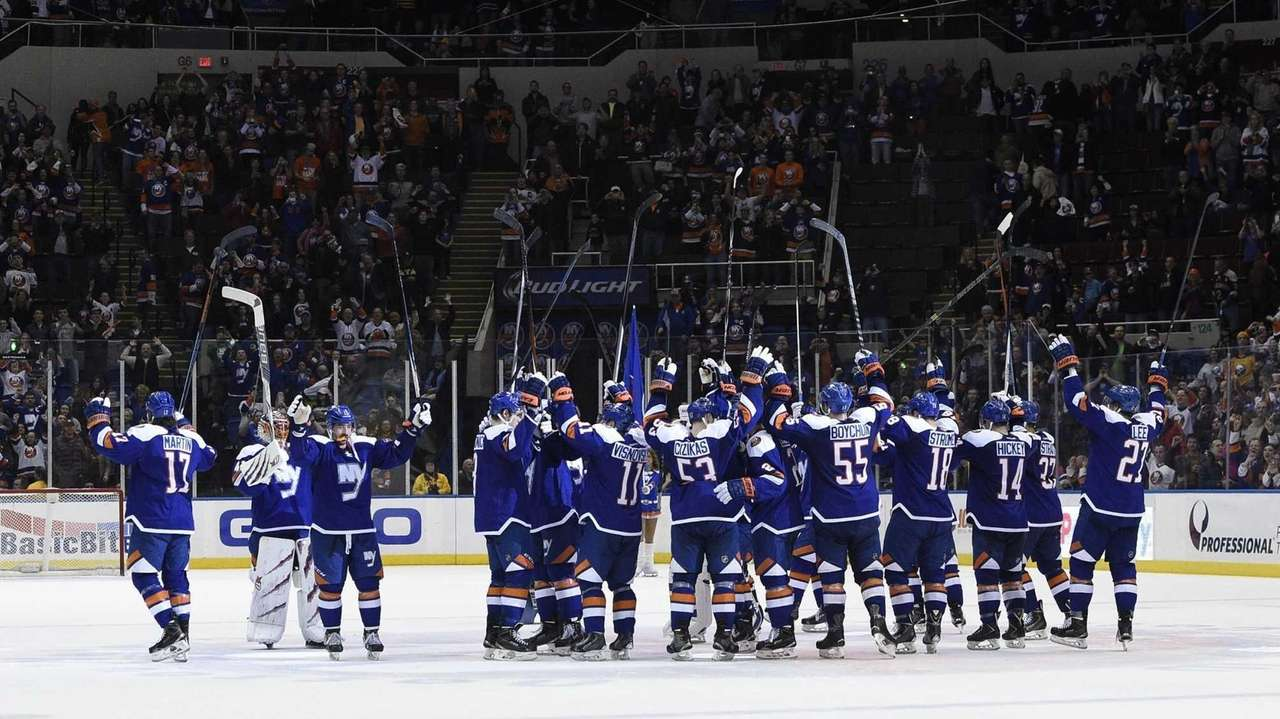 The New York Islanders salute the fans after