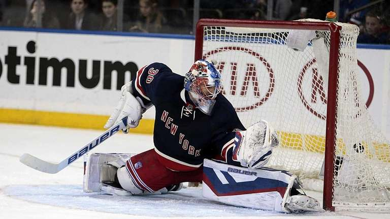 New York Rangers goalie Henrik Lundqvist gives up