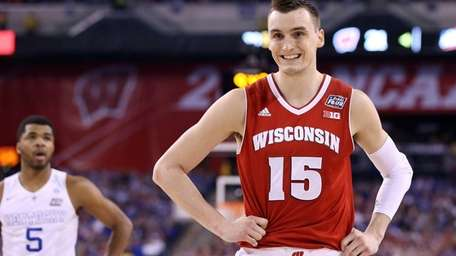 Sam Dekker of the Wisconsin Badgers reacts after