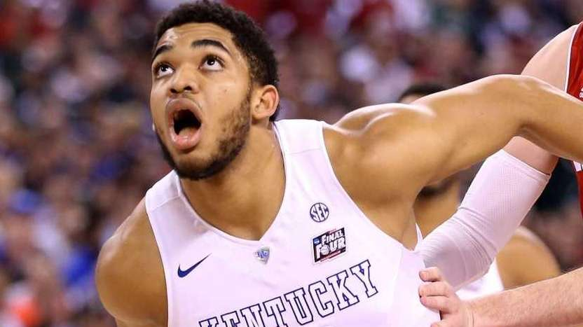 Karl-Anthony Towns, left, and Devin Booker of the