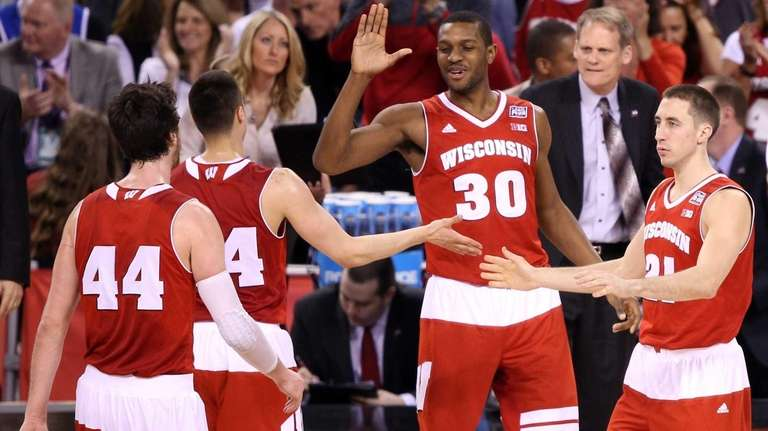 Frank Kaminsky, left, Bronson Koenig, Vitto Brown and