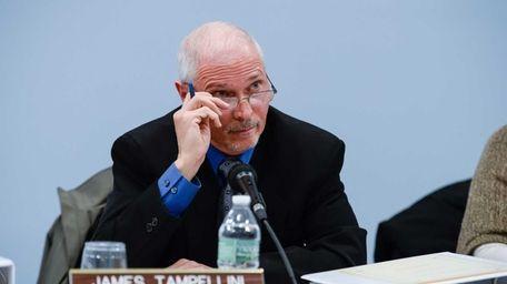 Trustee James Tampellini speaks during a Commack School