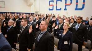 Recruits stand ready to serve at the Suffolk