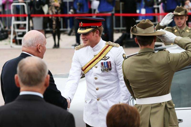 Prince Harry is greeted by Australian Gov. Gen.