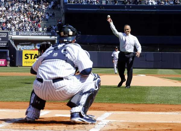 Former Yankees manager Joe Torre throws the ceremonial