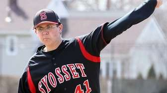 Syosset pitcher Jonathan Doyle throws against Hicksville in