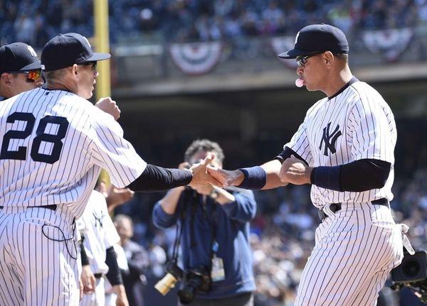 New York Yankees third baseman Alex Rodriguez shakes