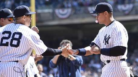 New York Yankees third baseman Alex Rodriguez shakes