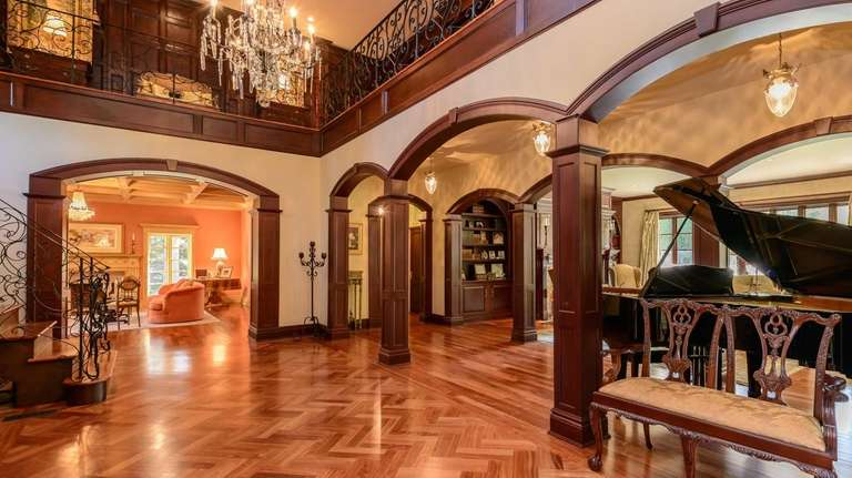 The mahogany floors glow under the arched architectural