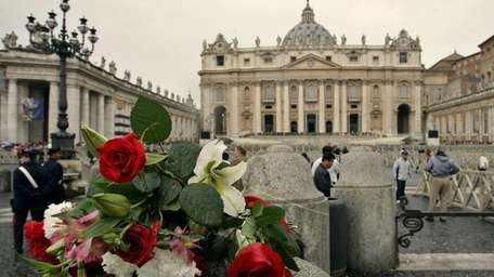Flowers in St. Peter's Square a day after
