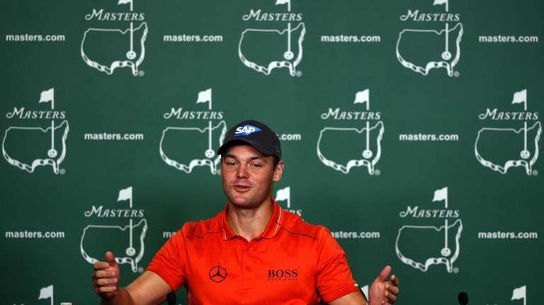 Martin Kaymer of Germany is interviewed during a