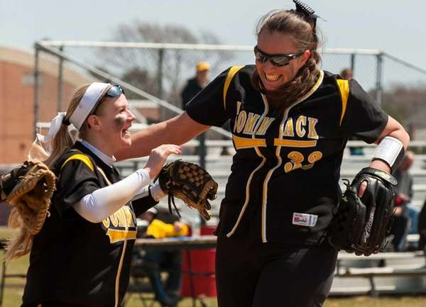 Commack's Jill McFadzen congratulates starting pitcher Alyssa Bluethgen