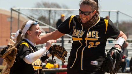 Commack's Jill McFadzen congratulates starting pitcher Alyssa Bluethgen