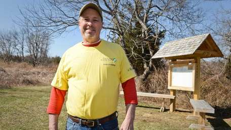 Volunteer preserve monitor Bob Kemmann stands near a