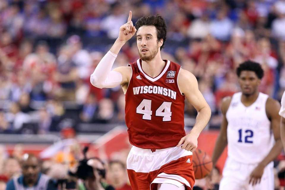 Frank Kaminsky of the Wisconsin Badgers reacts after