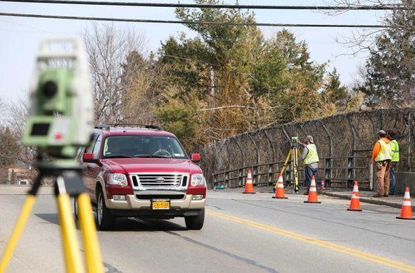 Surveying equipment is used on the Ellison Avenue