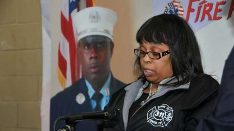 Jacqueline Scott-Sanford, the widow of 43-year-old volunteer firefighter