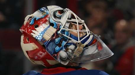 Cam Talbot of the Rangers takes a break