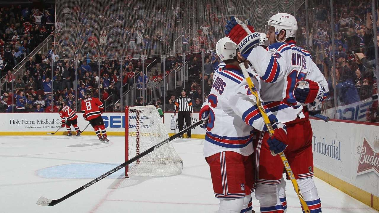 The New York Rangers celebrate an empty-net goal