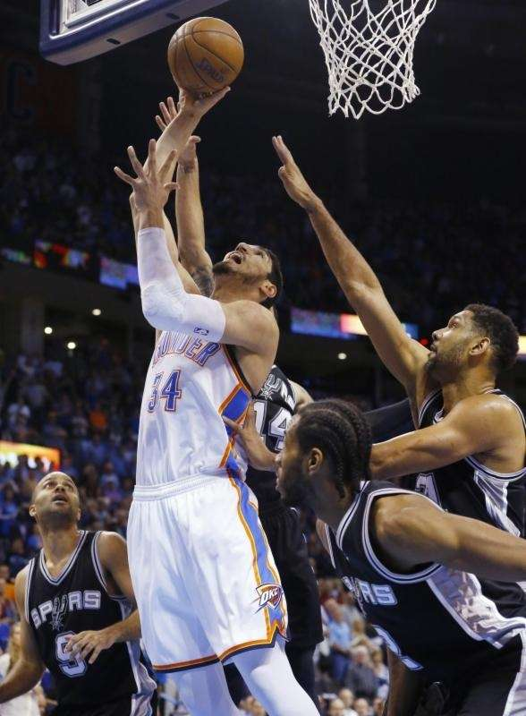 Oklahoma City Thunder center Enes Kanter (34) shoots