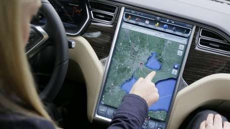 Alexis Georgeson of Tesla Motors, shows off the