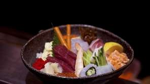 The chirashi bowl-- assorted sashimi (raw fish), vegetables