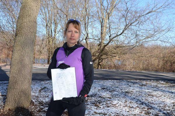 Eva Casale, of Glen Cove, holds a list