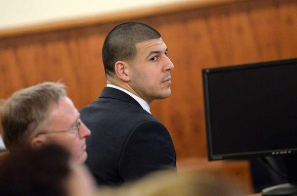 Former New England Patriots player Aaron Hernandez sits