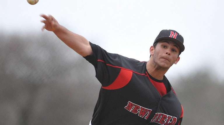 Newfield pitcher Brandon Alberto delivers to the plate