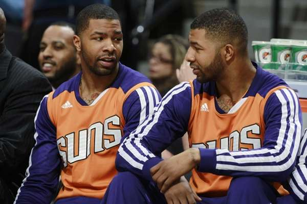 Phoenix Suns forwards Marcus Morris, left, and his