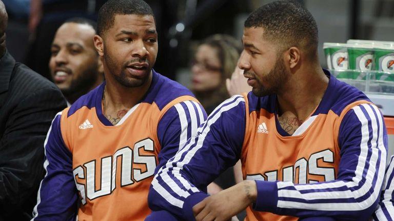 Phoenix Suns forwards Marcus Morris, left, and his