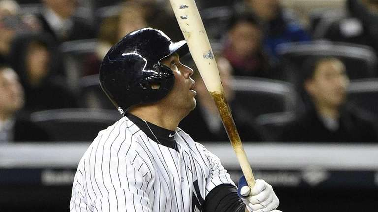 New York Yankees designated hitter Carlos Beltran flies