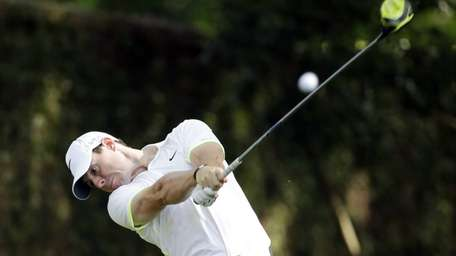 Rory McIlroy tees off on the second hole