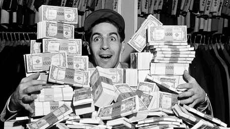 Phil Rizzuto, Yankees shortstop, poses with a pile