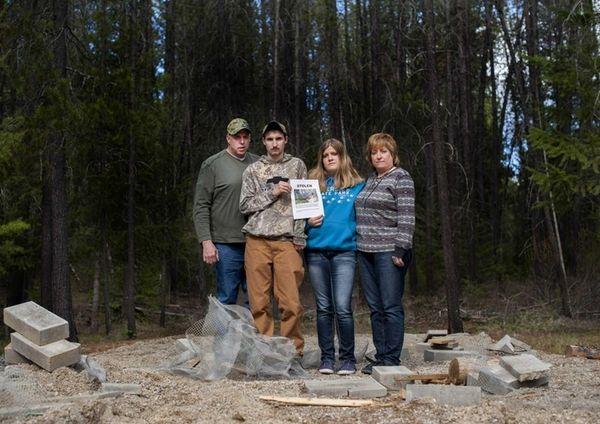 Moose Hempel, left, stands with his children, Tyler