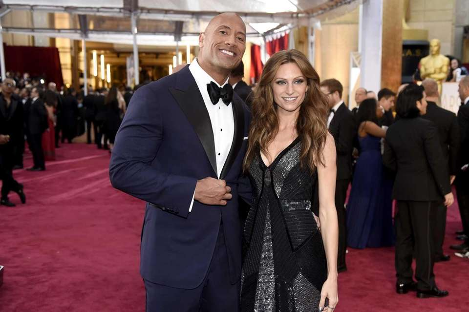 Dwayne Johnson, left, and Lauren Hashian arrive at