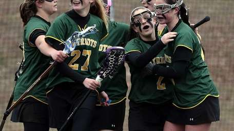 Ward Melville's Samantha Nemirov is surrounded by teammates
