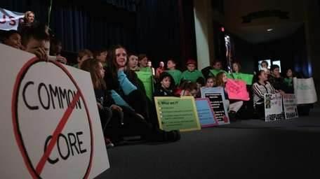 Children hold up signs during the first New
