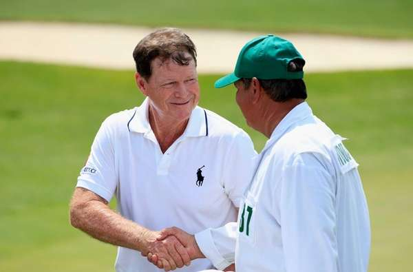 Tom Watson, left, shakes hands with caddie Tony