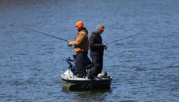 Two unidentified men fish in Lake Ronkonkoma on