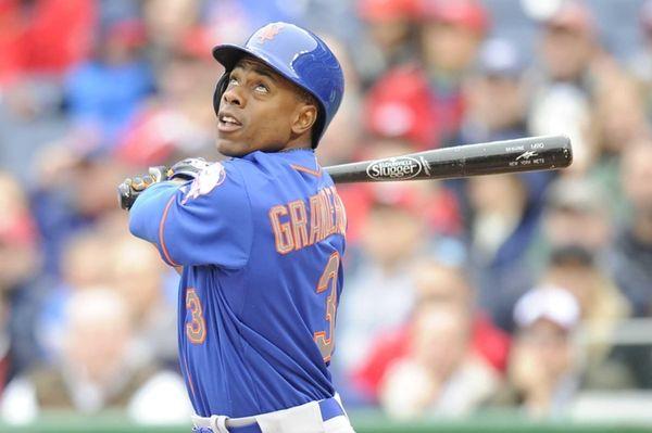 Curtis Granderson of the New York Mets singles
