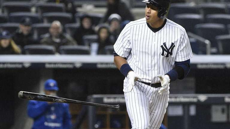 New York Yankees designated hitter Alex Rodriguez tosses