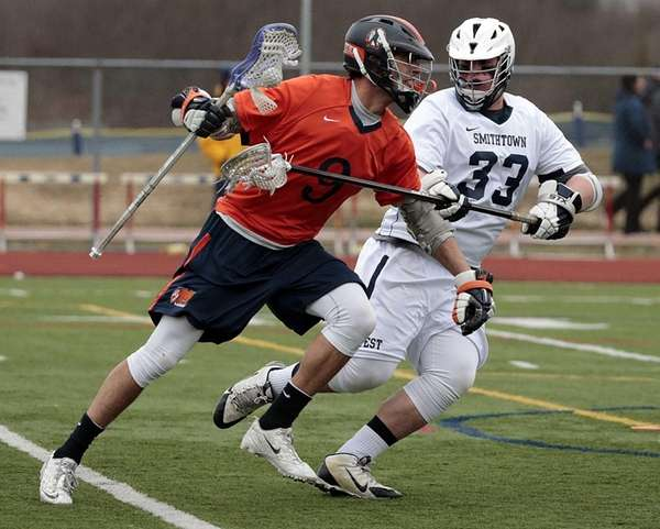 Manhasset's Thomas Duran (9) drives from behind the