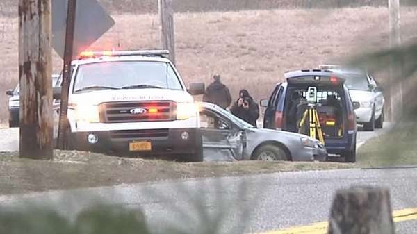 Investigators at the scene of an accident on