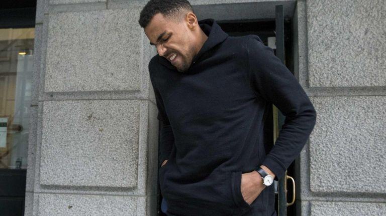 Atlanta Hawks player Thabo Sefolosha leaves a courthouse