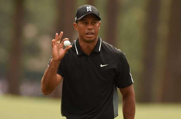 Tiger Woods holds his ball after a putt